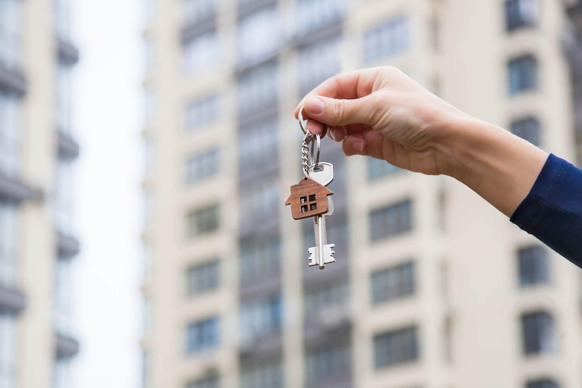 Key with a house-shaped pendant