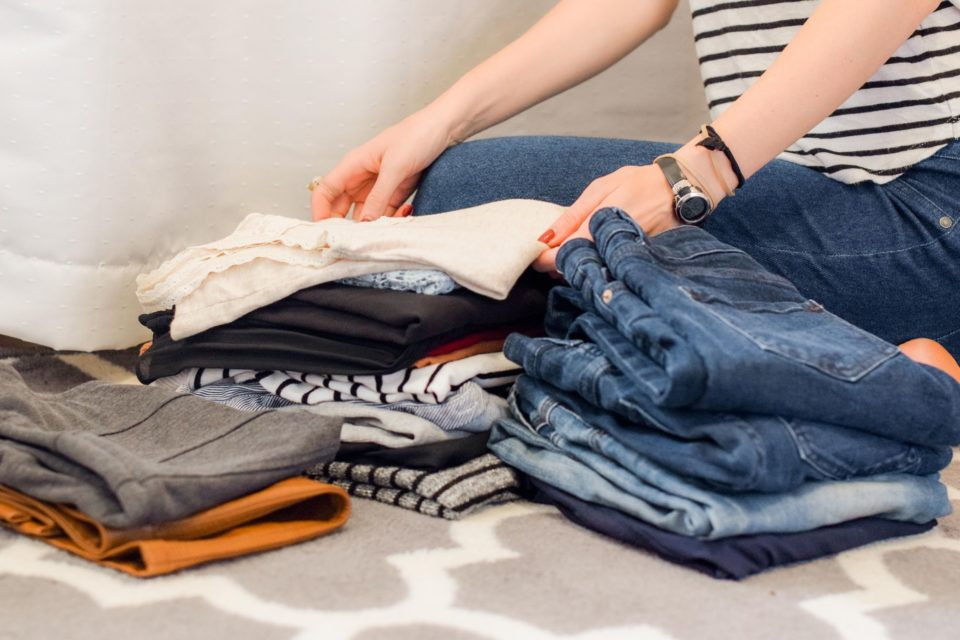 woman is sorting out her clothes
